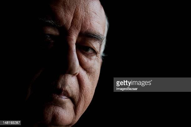 Studio portrait of senior man