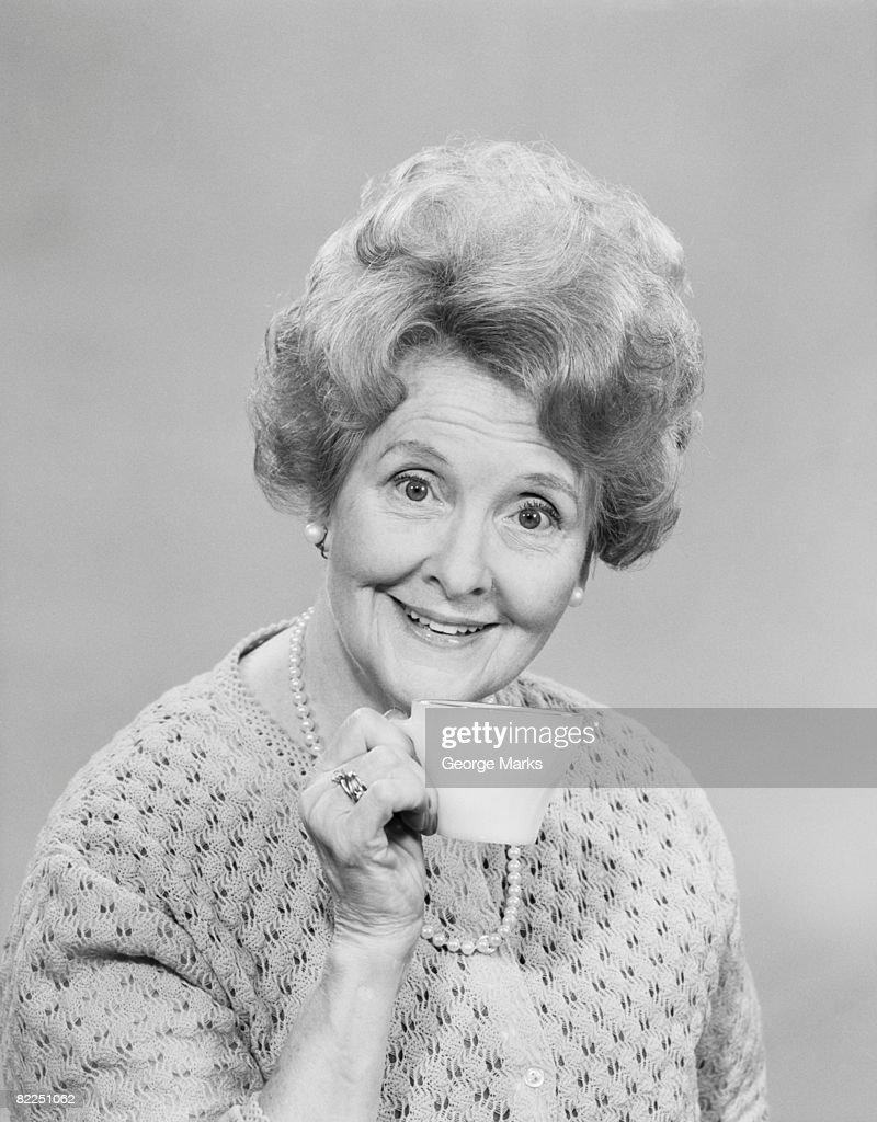 Studio portrait of senior woman with tea cup : Stock Photo