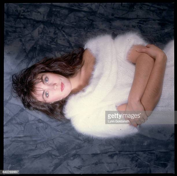 Studio portrait of singer Laura Branigan She is shown waistup wearing a white angora sweater Undated photograph