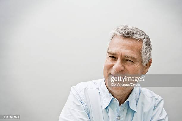studio portrait of smiling senior man - one man only stock pictures, royalty-free photos & images