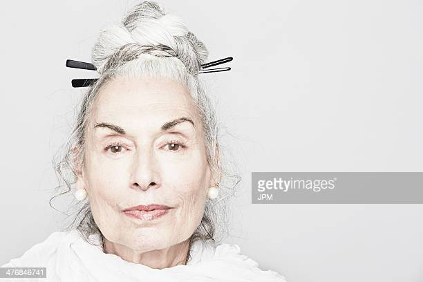 Studio portrait of sophisticated senior woman