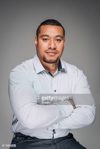 Studio portrait of strong masculine Aboriginal or Maori guy