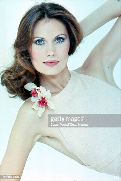 Studio portrait of Swedish model and actress Maud Adams as she poses in a halterneck dress against a white background April 1975