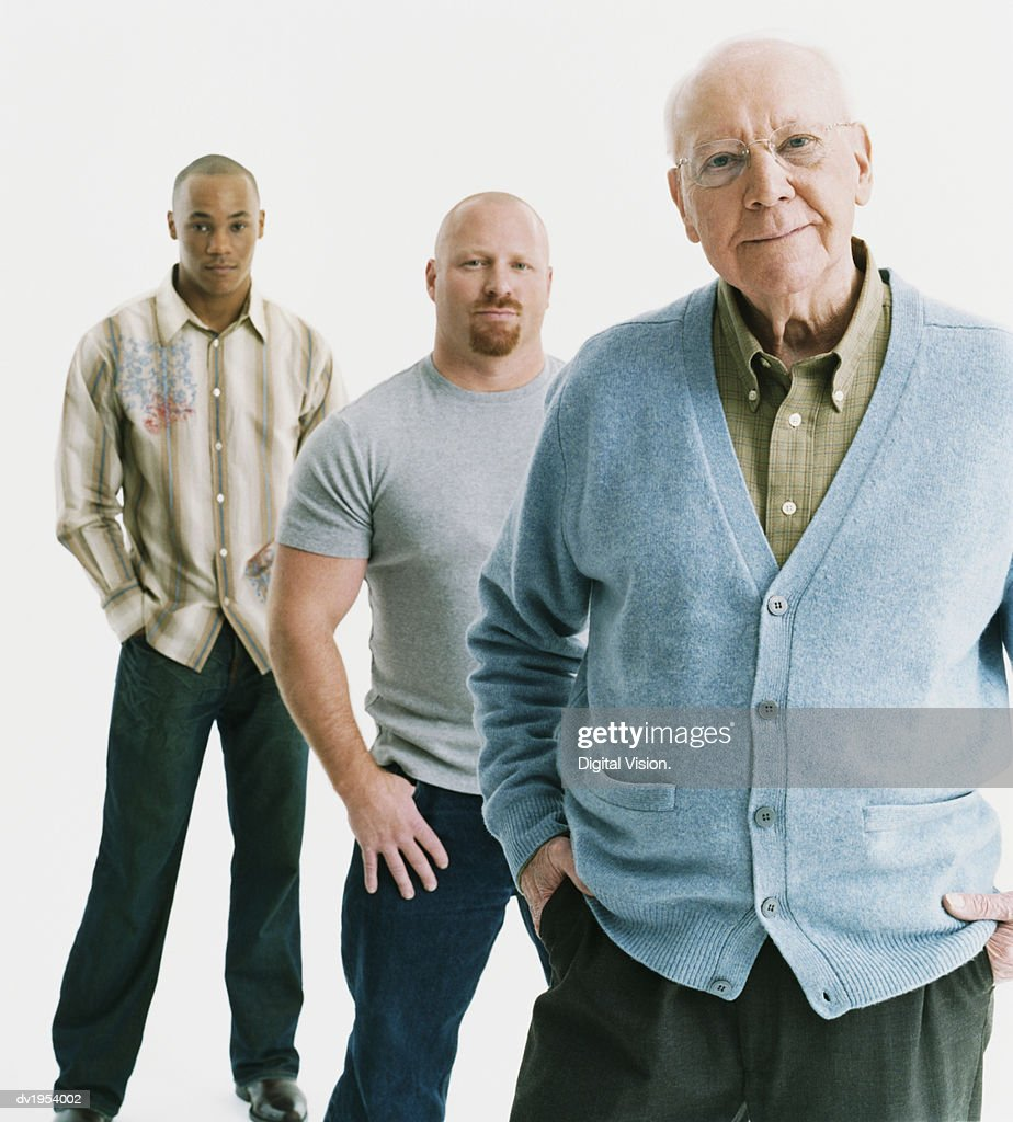 Studio Portrait of Three Serious Men of Mixed Ages Standing in a Line, Senior Man at the Front : Stock Photo