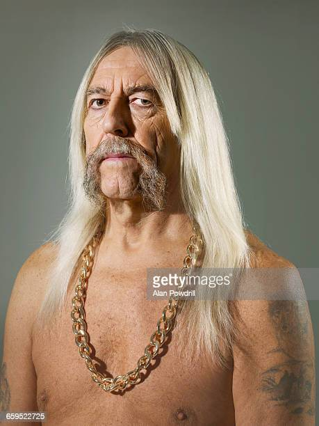 studio portrait of topless biker man - gold chain stock pictures, royalty-free photos & images