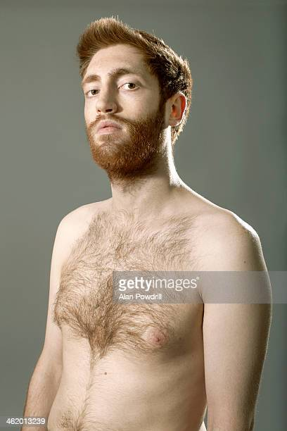studio portrait of topless man with beard - hairy chest stock-fotos und bilder