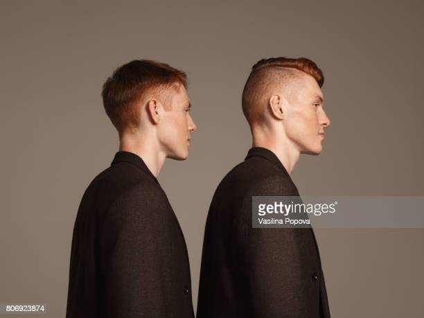 studio portrait of twins - brown suit stock photos and pictures