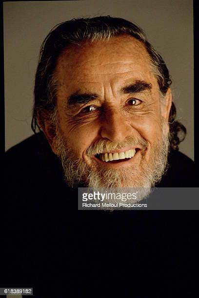 Studio portrait of Vittorio Gassman smiling.