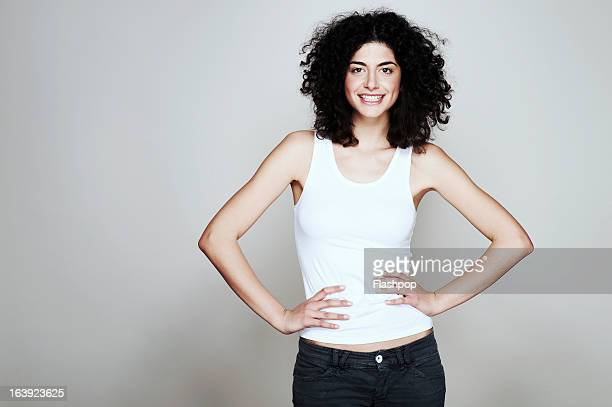 studio portrait of woman - arms akimbo stock pictures, royalty-free photos & images