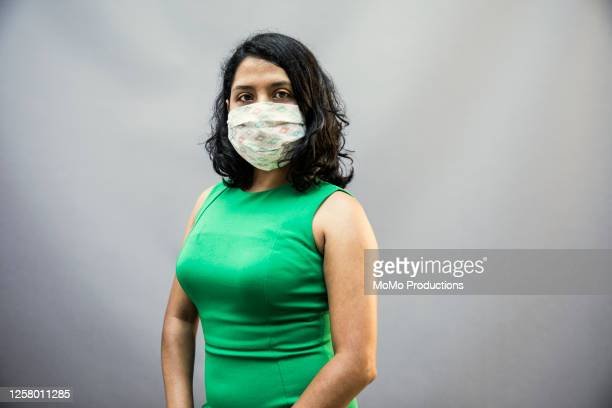 studio portrait of woman wearing protective mask - sleeveless stock pictures, royalty-free photos & images