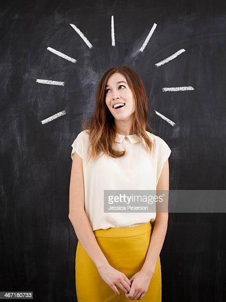 Studio portrait of woman with chalk beams