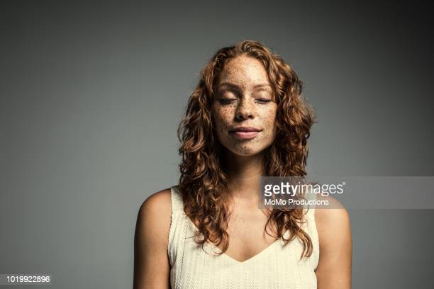 studio portrait of woman with freckles - eyes closed stock pictures, royalty-free photos & images
