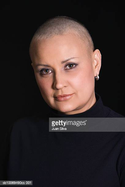 studio portrait of woman with shaved head - bald woman stock photos and pictures
