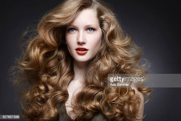 Studio portrait of woman with wavy hair