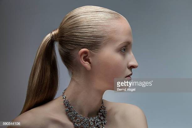 Studio portrait of young blonde woman with diamonds