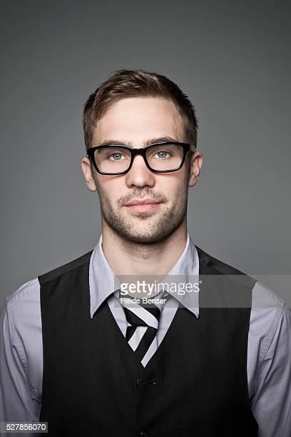 Studio portrait of young business man