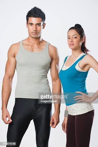 Studio portrait of young couple in sportswear