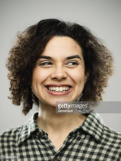 studio portrait of young happy woman with excited expression looking to the side - sideways glance stock pictures, royalty-free photos & images