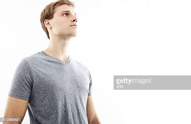 Studio portrait of young man gazing upward