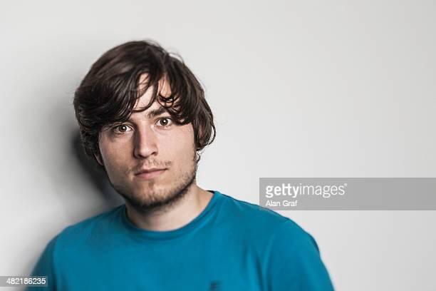 Studio portrait of young man in blue tshirt