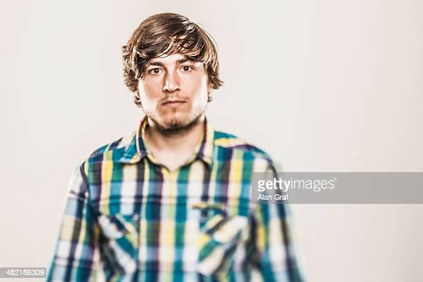 Studio portrait of young man in checked shirt