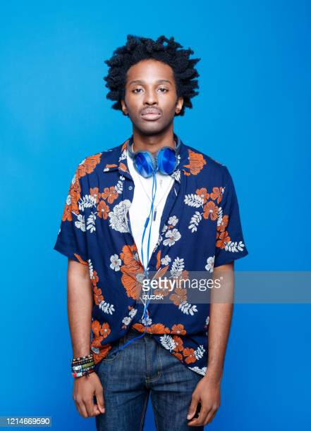 studio portrait of young man in hawaiian shirt - funky stock pictures, royalty-free photos & images