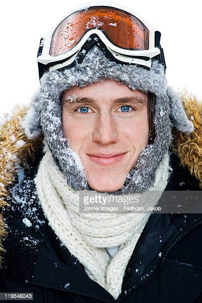 Studio portrait of young man in ski-wear