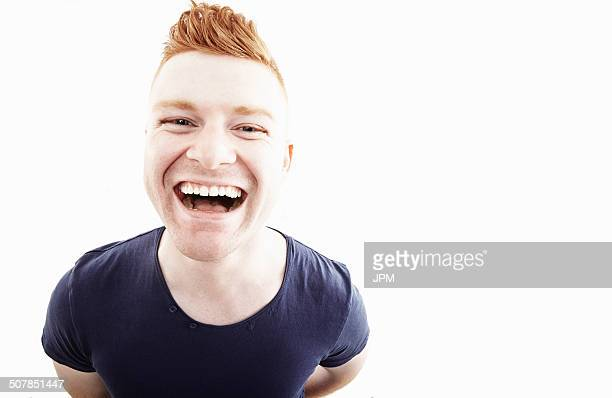 Studio portrait of young man laughing
