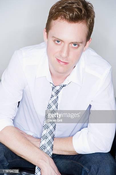 Studio portrait of young man smirking
