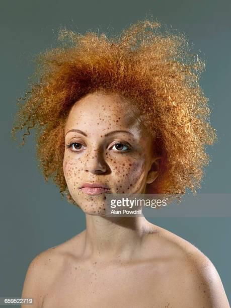 Studio portrait of young mixed race girl.