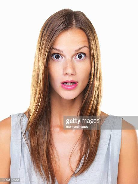 Studio portrait of young surprised woman staring on camera