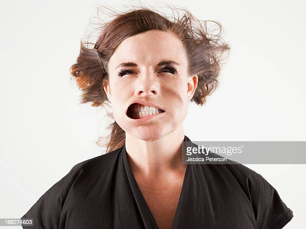 studio portrait of young woman facing wind - ugly black women stock photos and pictures