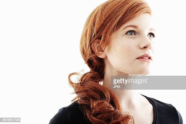 studio portrait of young woman gazing upwards - looking away stock pictures, royalty-free photos & images