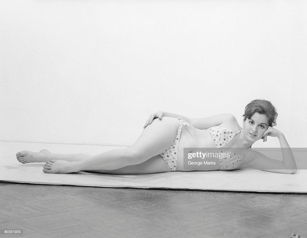 Studio portrait of young woman in bikini : Stock Photo