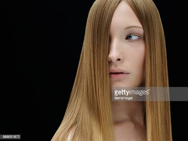 studio portrait of young woman - straight hair stock pictures, royalty-free photos & images