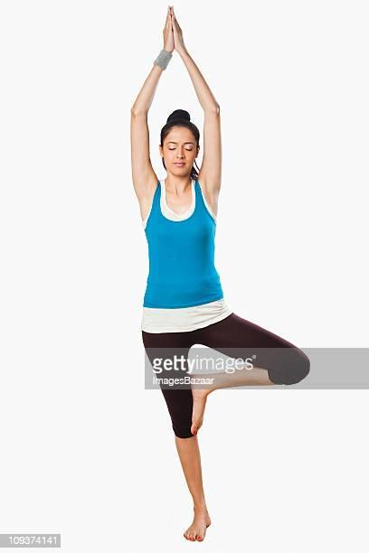 Studio portrait of young woman practicing yoga