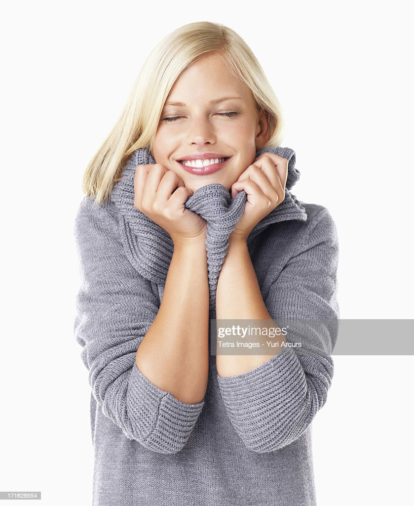 Studio portrait of young woman wearing gray sweater : Stock Photo