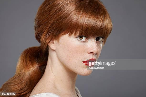 Studio portrait of young woman wearing lipstick