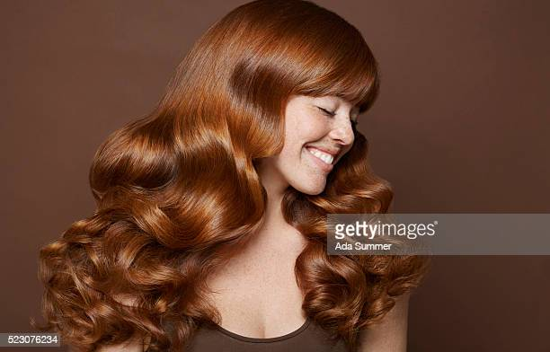 studio portrait of young woman with long brown hair - wavy hair stock pictures, royalty-free photos & images