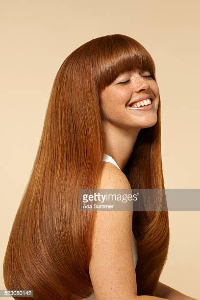 studio portrait of young woman with long brown hair - straight hair stock pictures, royalty-free photos & images