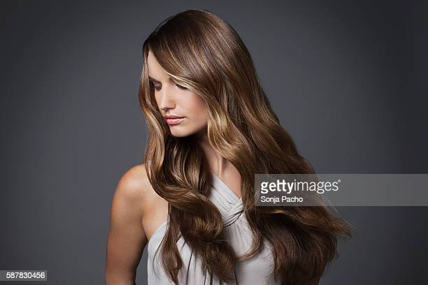 studio portrait of young woman with long brown hair - thick white women stock photos and pictures