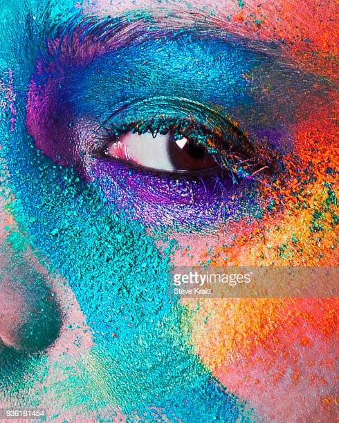 studio portrait of young womans face with multi coloured powder eye shadow, close up - female anatomy stock photos and pictures