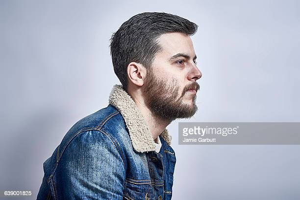 Studio profile portrait of bearded male
