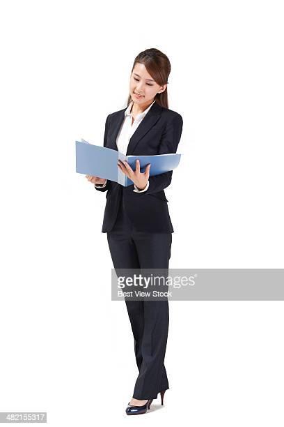 studio shot business woman holding document - 若い女性一人 ストックフォトと画像