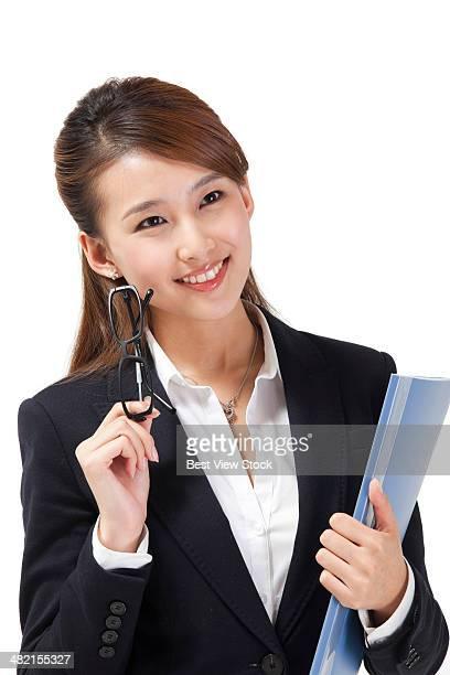 studio shot business woman holding glasses
