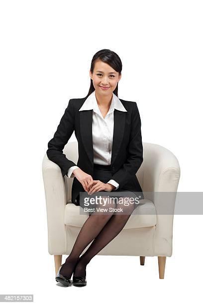 studio shot business woman on the sofa