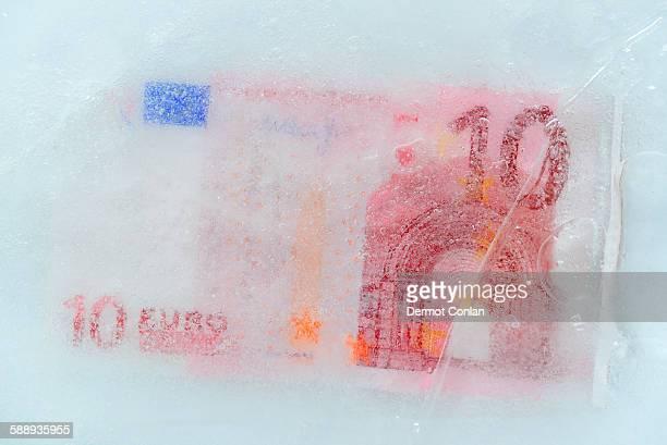 Studio Shot of 10 euro bill frozen in ice