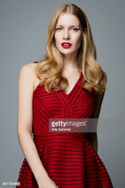 studio shot  of a beautiful woman in a red dress