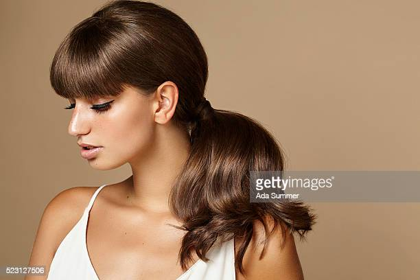 studio shot of a beautiful young brunette with long shiny hair