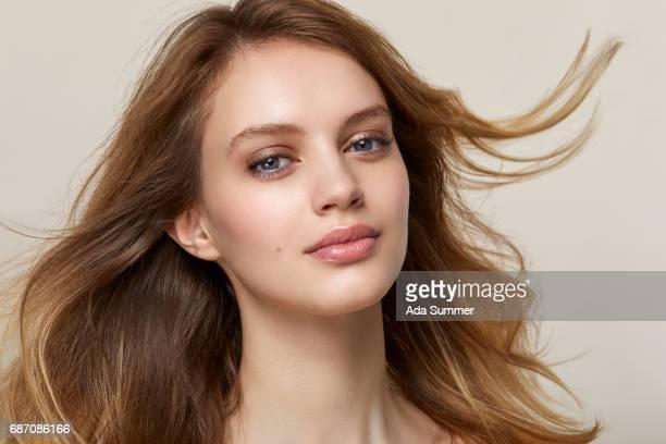 studio shot of a beautiful young woman